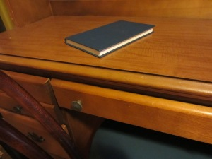 an unread book on a desk